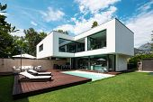 Exterior modern white villa with pool and garden, nobody inside poster