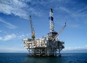 stock photo of oil rig  - Large Pacific Ocean oil rig drilling platform off the southern coast of California - JPG