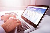 Businessman Filling Online Registration Form poster