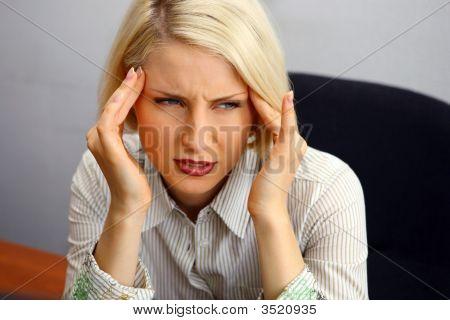 Woman With Severe Headache (Migraine).