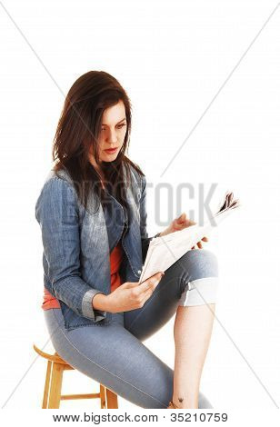 Girl reading the paper.