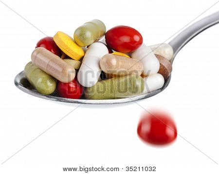 Spoon Piled With Pills