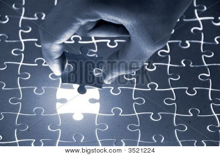 Holding A Puzzle Piece 2