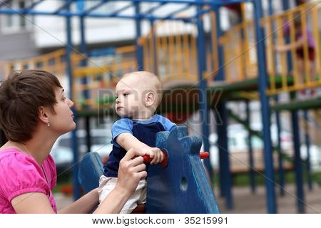 Child With Mother At Playground