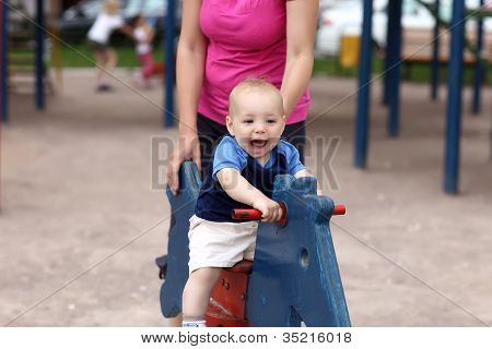 Happy Child On Wooden Horse