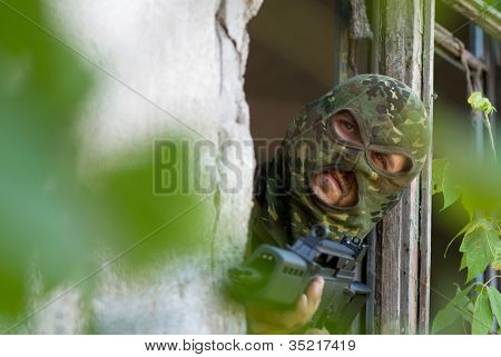 Armed Terrorist Looking Out Of Window