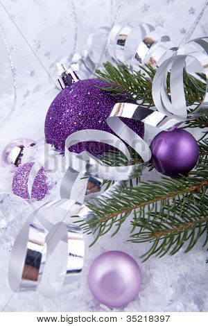 Beautiful Christmas Decoration In Purple And Silver On White Snow