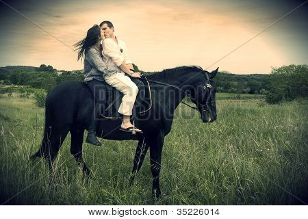 Couple And  Horse In A Field