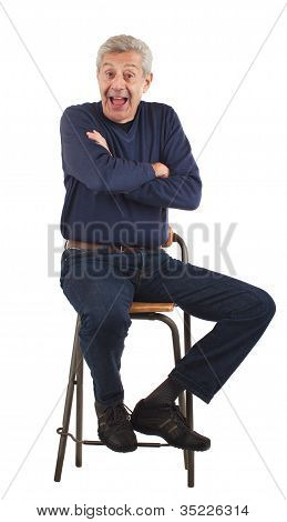 Happy Senior Man With Arms Crossed