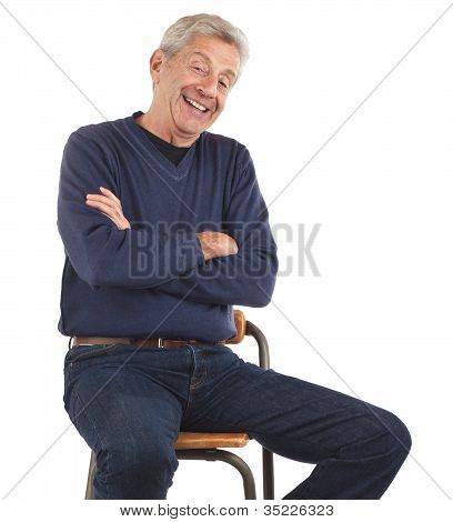 Laughing Senior Man Sitting With Arms Crossed