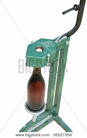 Bottle Capper And Wine Bottle (top View)