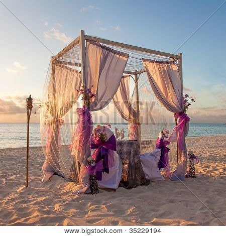 Romantic Wedding Table On Sandy Tropical Caribbean Beach At Sunset