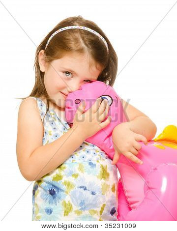 Portrait of a beautiful little girl hugging toy dinosaur Isolated on white background.