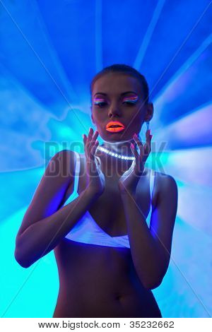 Sexy girl portrait with glow neon make-up