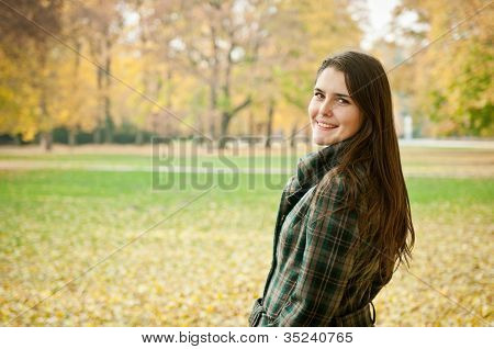 Outdoor autumn portrait of young woman