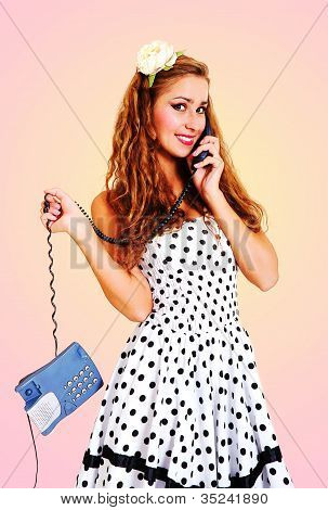 Young Beautiful Girl Talking On The Phone. Toned In Retro Style.