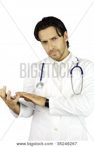 Serious Doctor Working With Tablet Looking