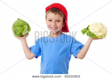 Smiling kid with cabbage and cauliflower