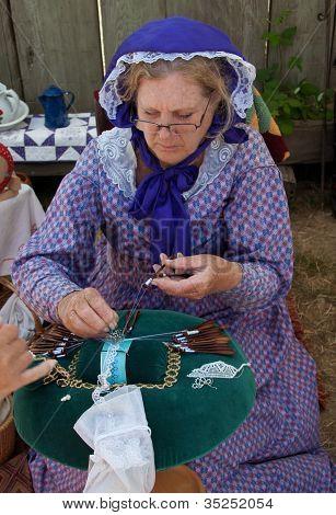 Woman In Costume Makes Bobbin Lace