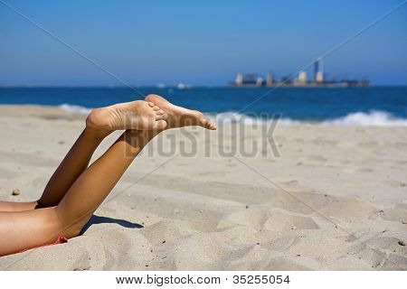 Beach Legs With Island In The Distance