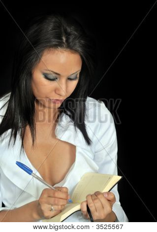 Woman Writing An Appointment In Her Calendar Book