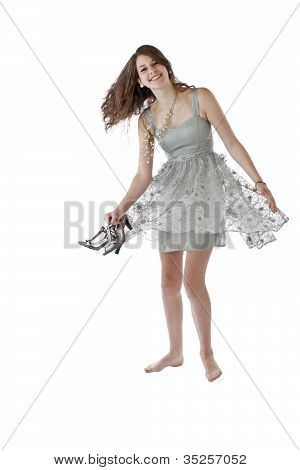 Teenage Girl In Lace Party Dress Holds Shoes And Dances
