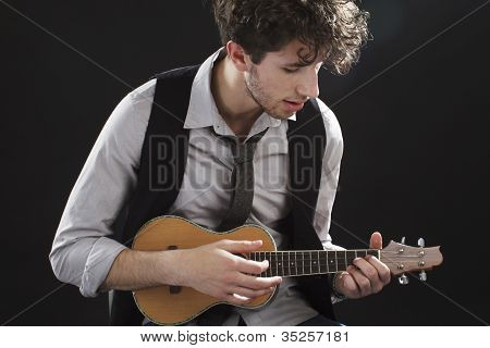 Closeup Of Young Man Playing A Ukelele