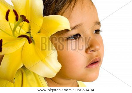 Little Girl With A Yellow Lily In Her Hair