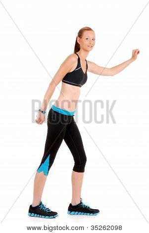 mulher vestindo roupa de fitness preto azul