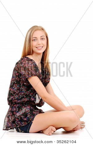 Young teen girl sitting crossed legged