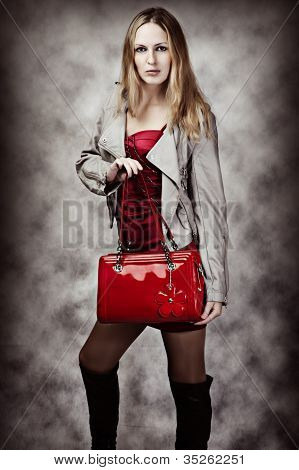 Fashion Portrait Of Sexy Woman With Bag