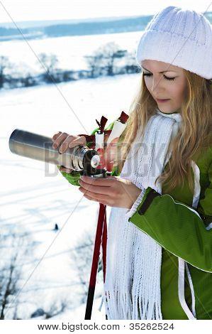 A Beautiful Girl Drinking At Ski Resort
