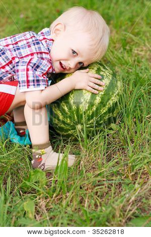 Happy Child Playing With Watermelon Outdoors