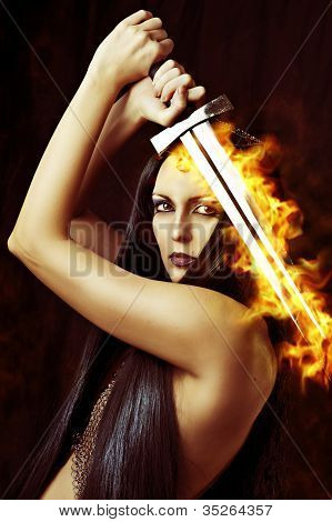 Young Sexy Woman Warrior With Sword