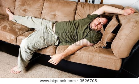 A Guy Flung All Over The Couch