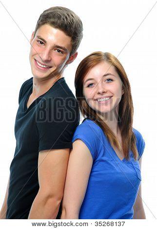 Teenage Couple Standing Back To Back