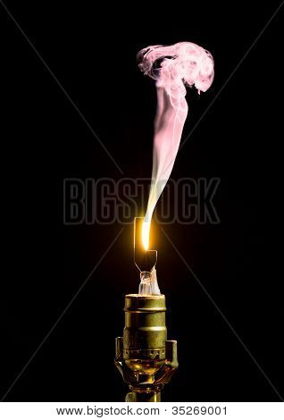 Broken Lightbulb Flares Up In Smoke