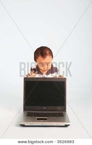 Curious Baby With Laptop