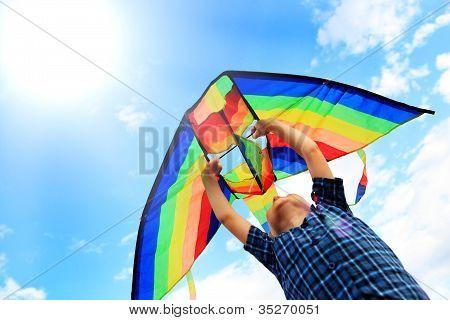 Llittle Boy Flies A Kite In The Sky