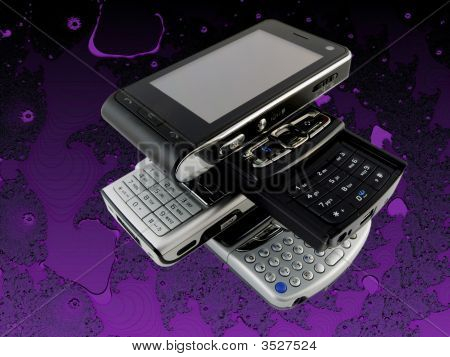 Stack Of Several Modern Mobile Phones On Purple Bright Fractal Background