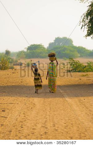 Mother Daughter Fetching Water Jugs Well