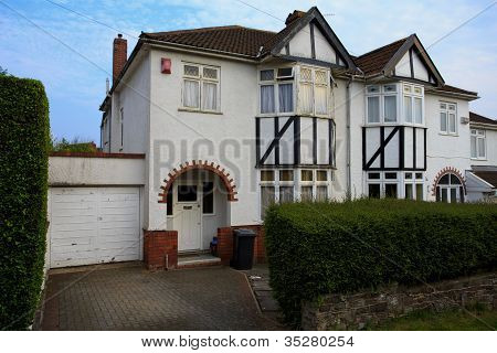 Typical 1930s white semi detatched house with Bay Window