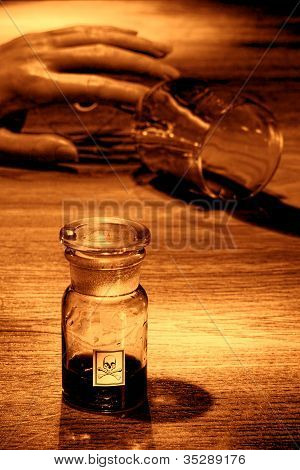 Crime Scene With Dead Woman Hand And Poison Bottle