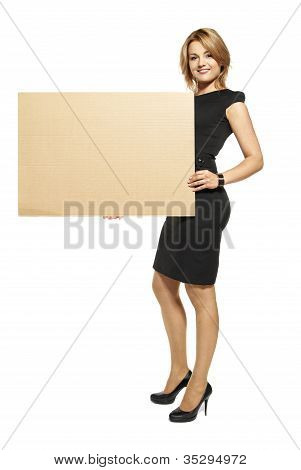 Attractive Woman Holding Up A Blank Sign - Isolated