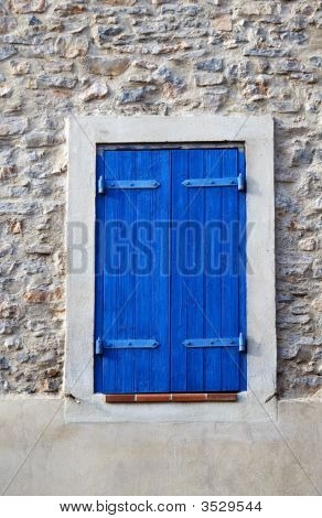 Window With Blue Shutter