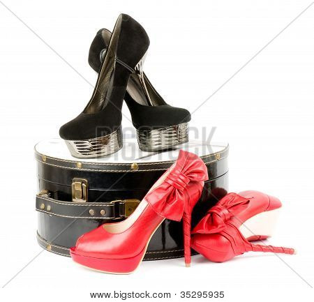 Sexy fashionable shoes with a box of isolated on a white background.