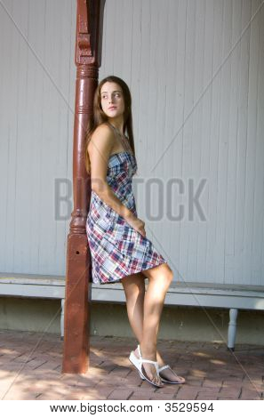 Girl Leaning On Red Pole