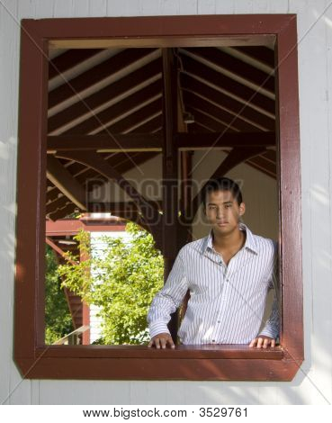 Teenage Boy In Red Window