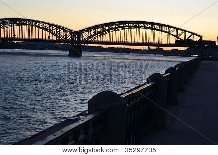 Neva river and Finnish railway bridge at sunset