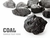 picture of briquette  - Coal lumps spilled on white background with copy space - JPG